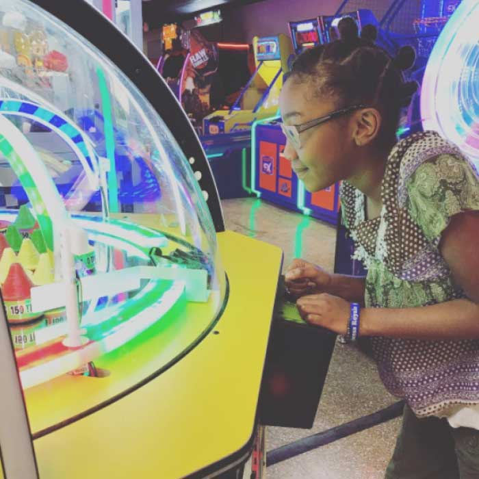 Young child playing new arcade games